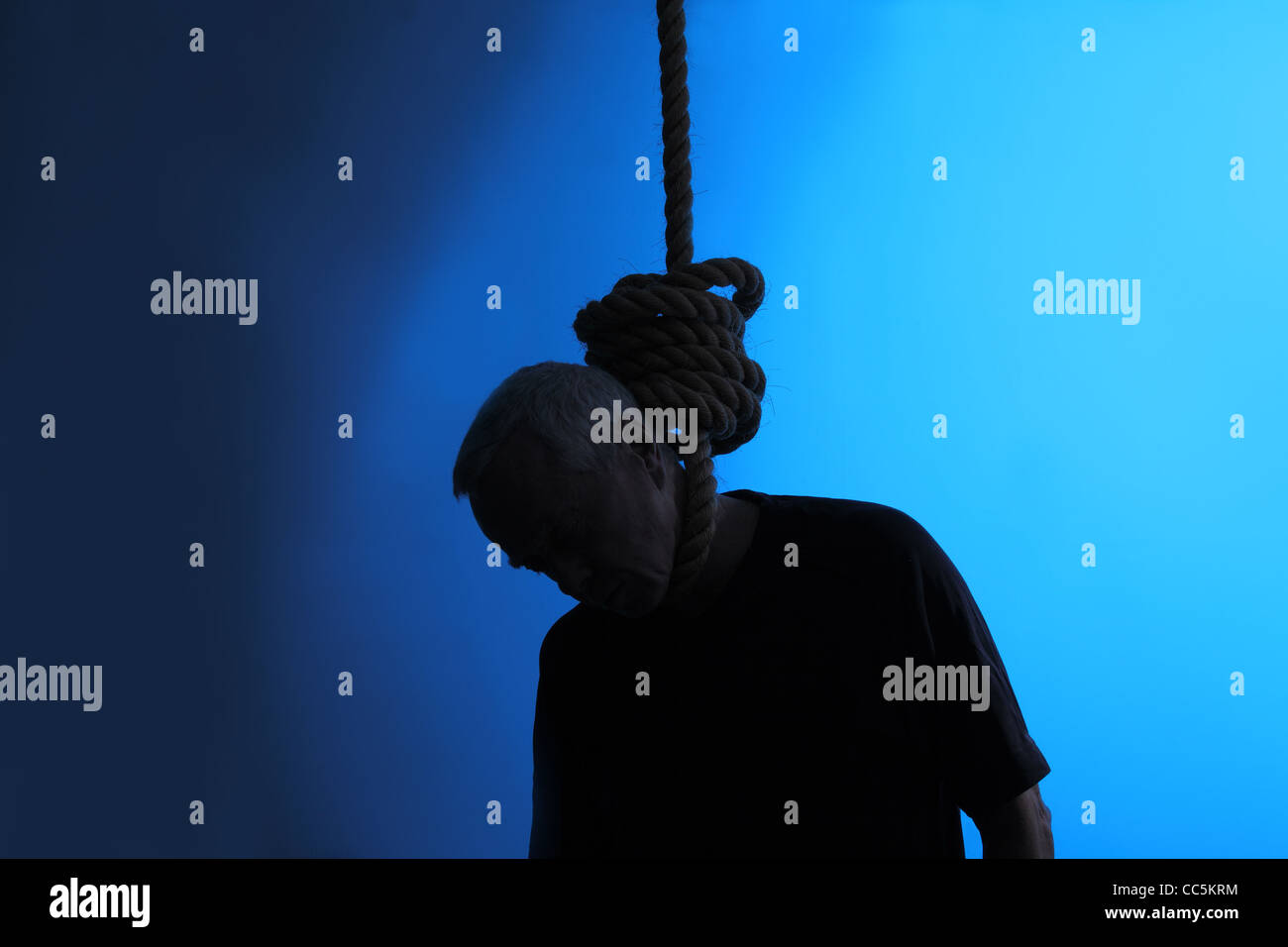 A man hanging with a noose around his neck - Stock Image