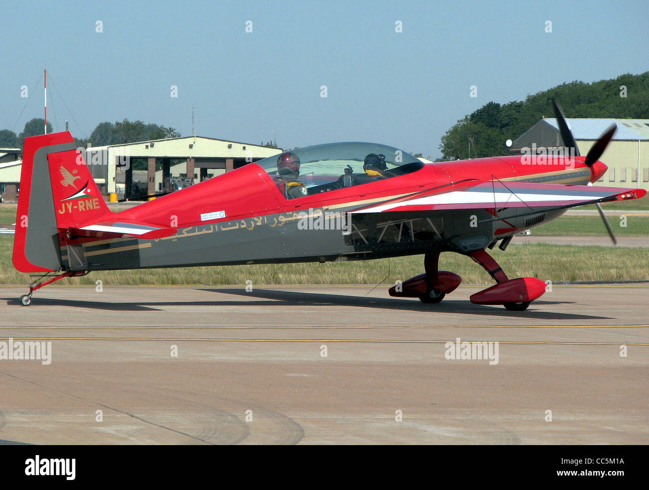 An Extra EA300S (JY-RNE) of the Royal Jordanian Falcons display team taxis for takeoff at the Royal International - Stock Image