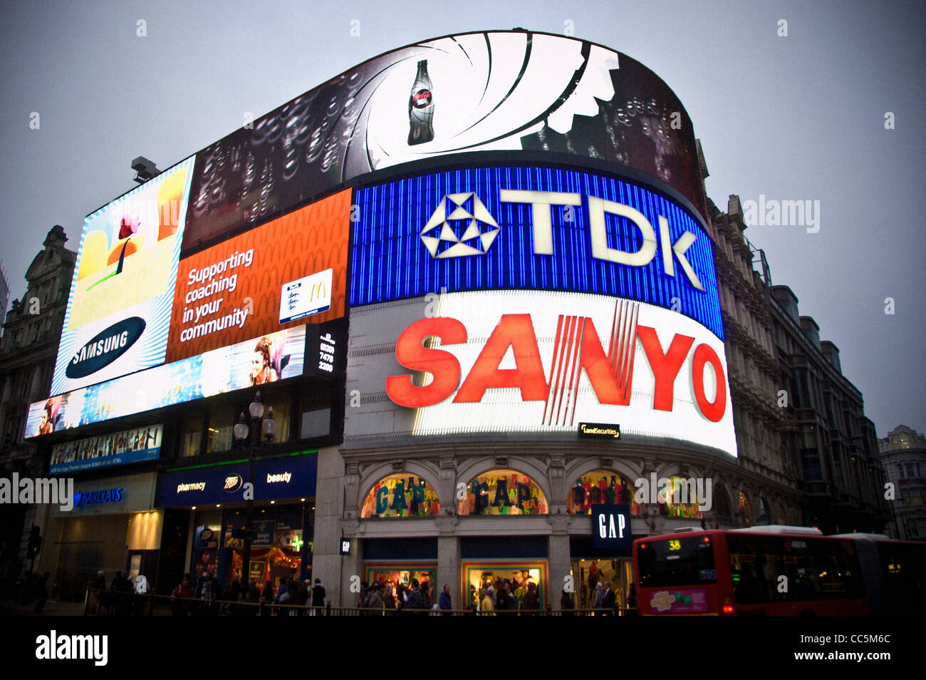Illuminated neon advertising signs at Piccadilly Circus, London. - Stock Image