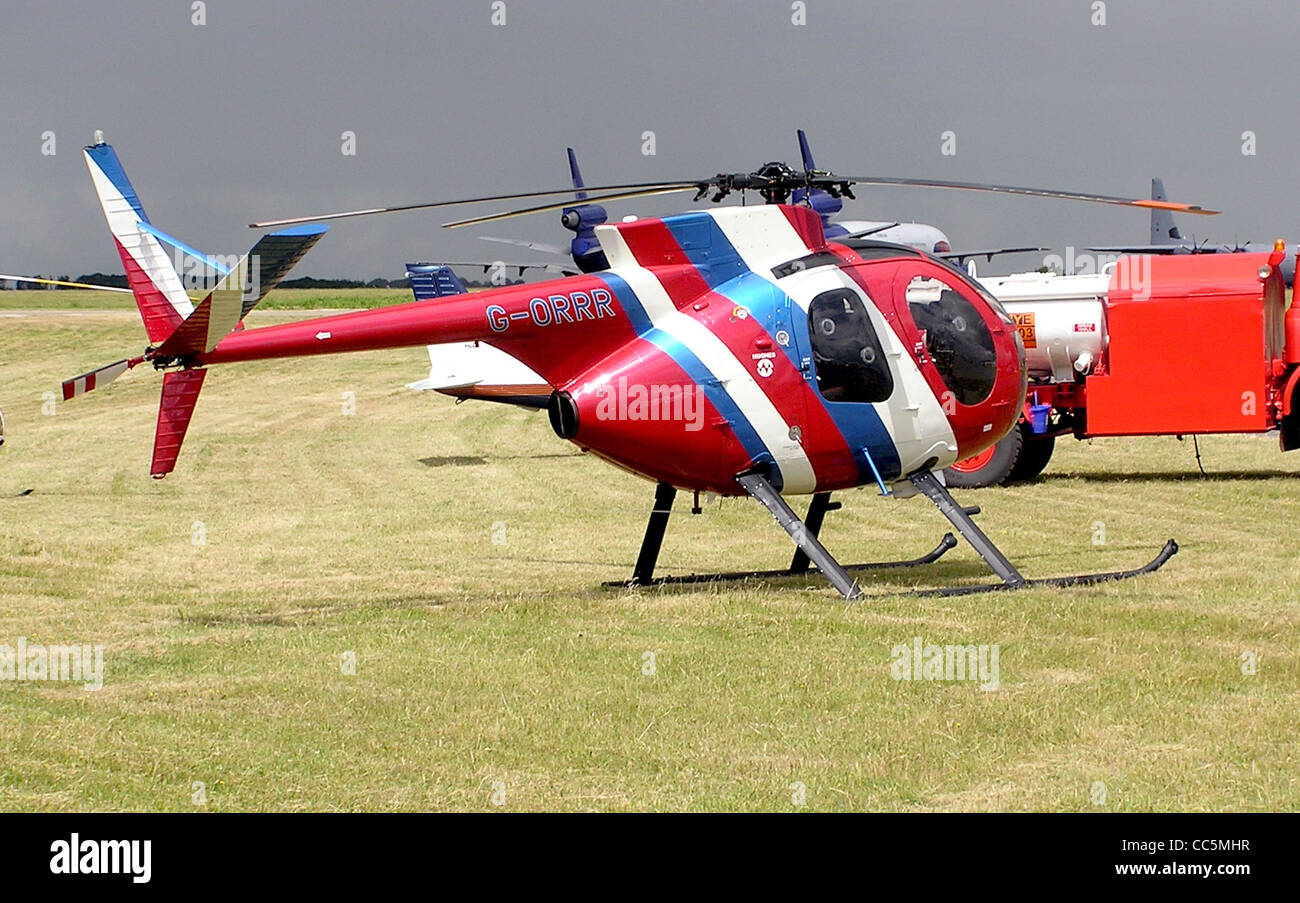 Hughes 500 Model 369HS (G-ORRR, built 1975) at Kemble Airfield, Gloucestershire, England. - Stock Image