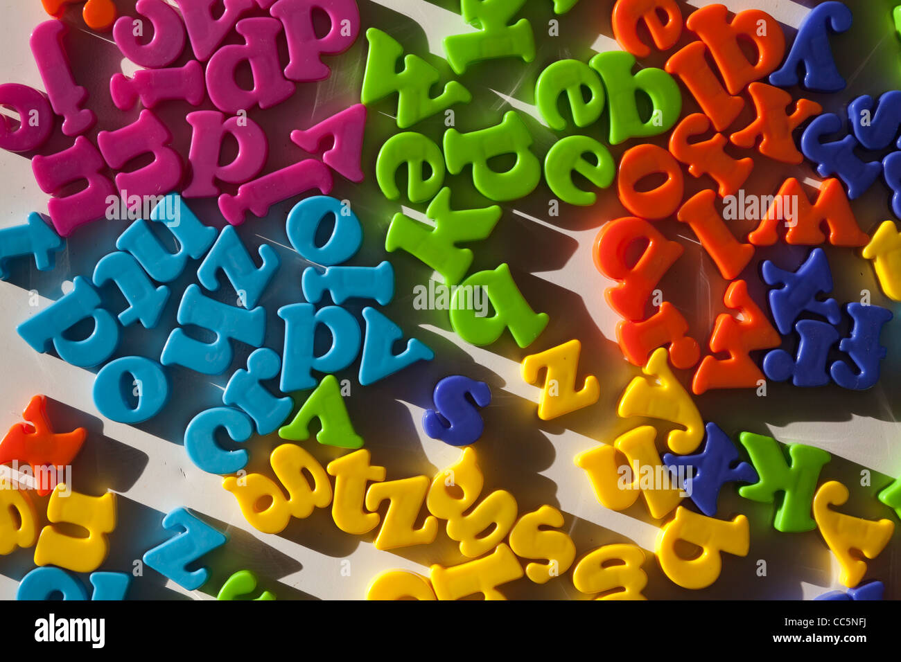 Colourful letters -fridge magnets - Stock Image