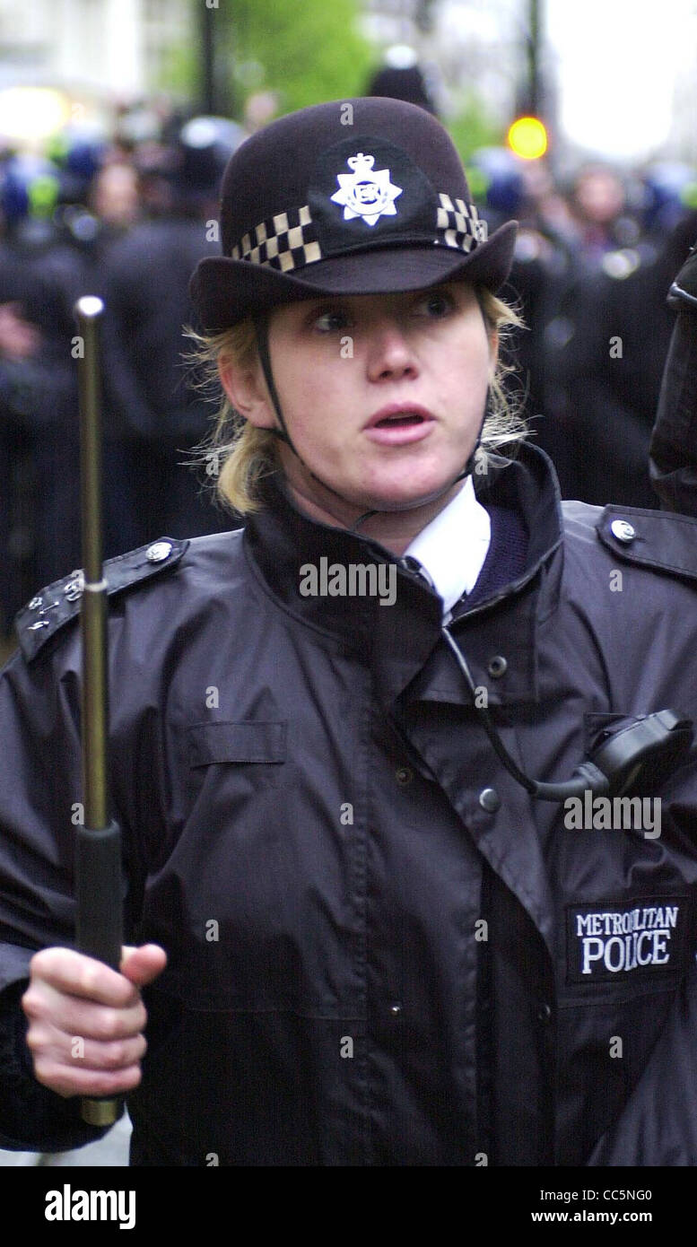 Street police officer with baton raised EDITORIAL USE ONLY - Stock Image