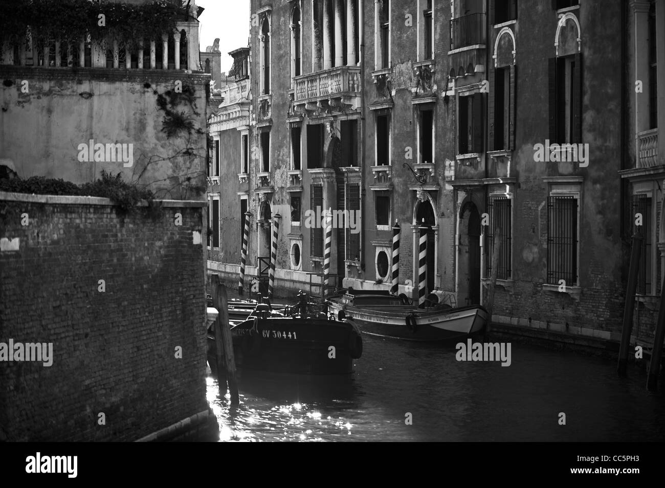 Black & White Detail of Venetian Canal with Boats - Stock Image