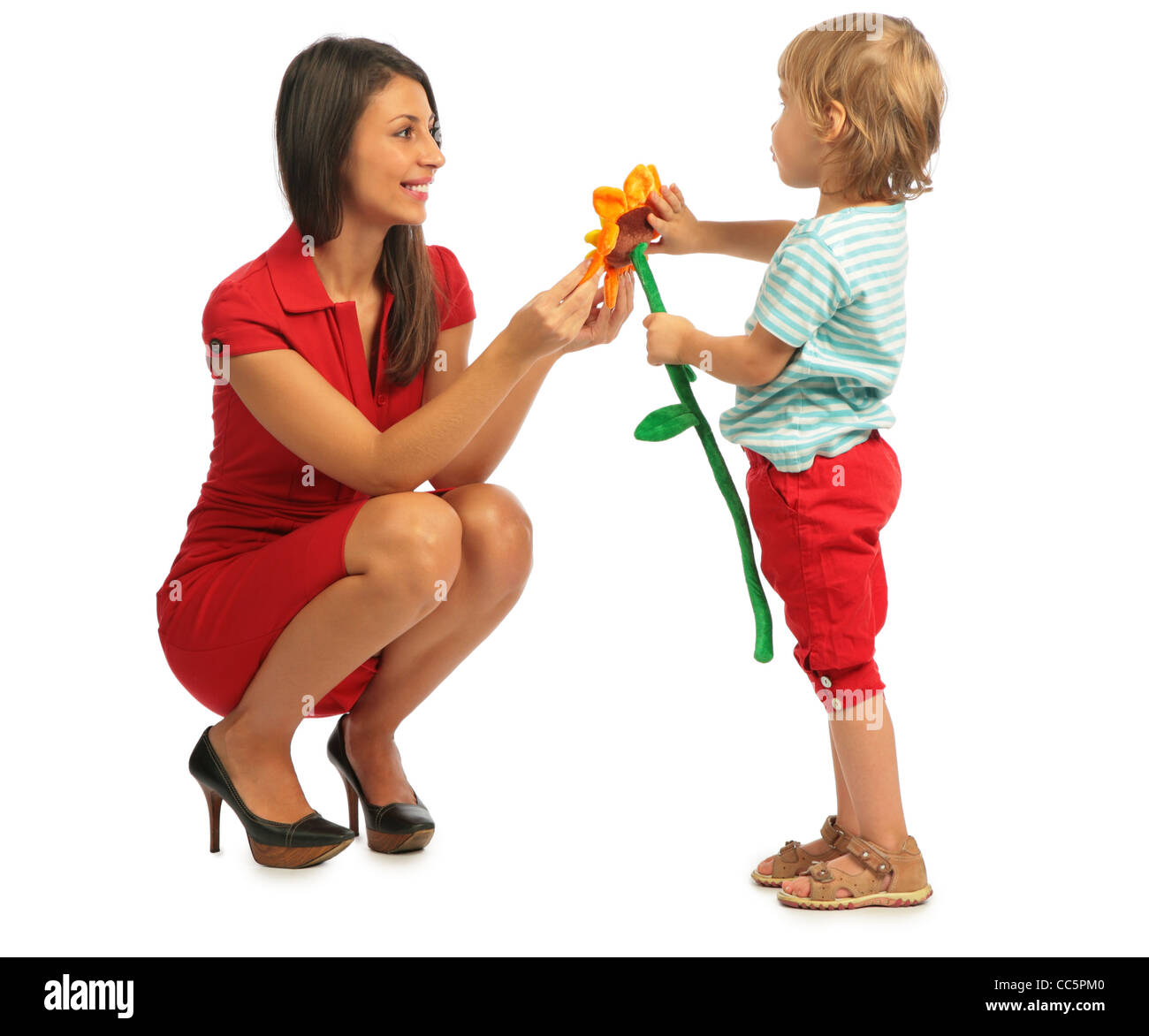 Little girl offer a plush flower to the woman - Stock Image