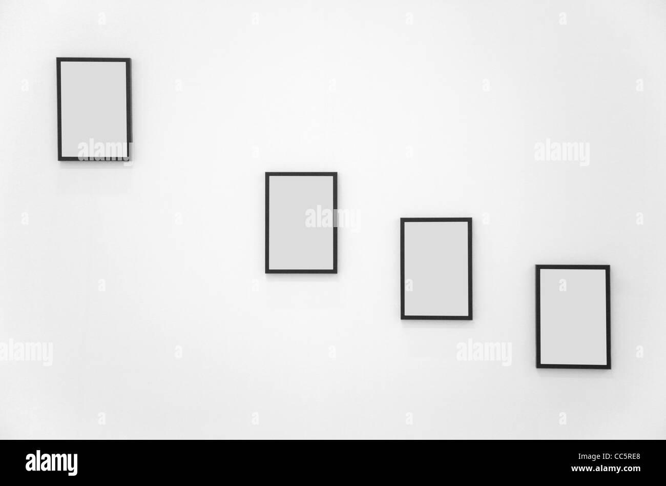 Four frames on white wall Stock Photo: 41924800 - Alamy
