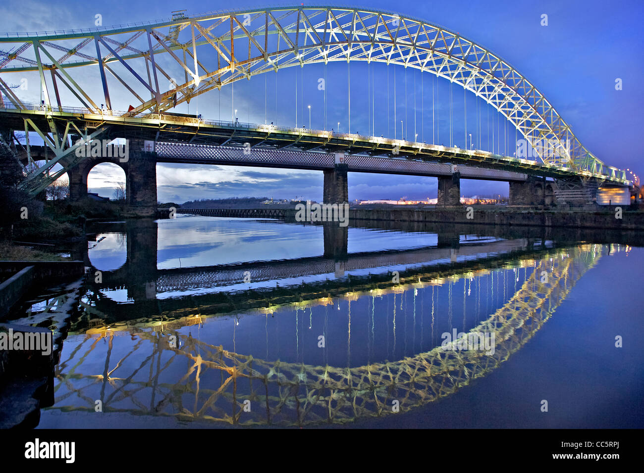 The Queensway bridge over the river Mersey between Runcorn and Widnes seen across the Manchester ship canal from - Stock Image