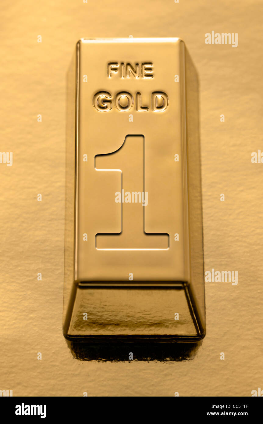 Gold Bar with a number one embossed on it on a gold background - Stock Image