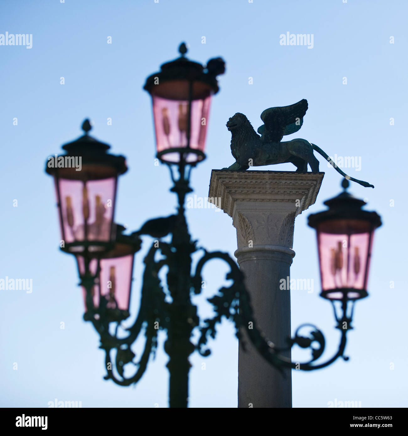 Streetlamp with pigeons, seagull and Lion of St Mark's Column in the Background - Stock Image