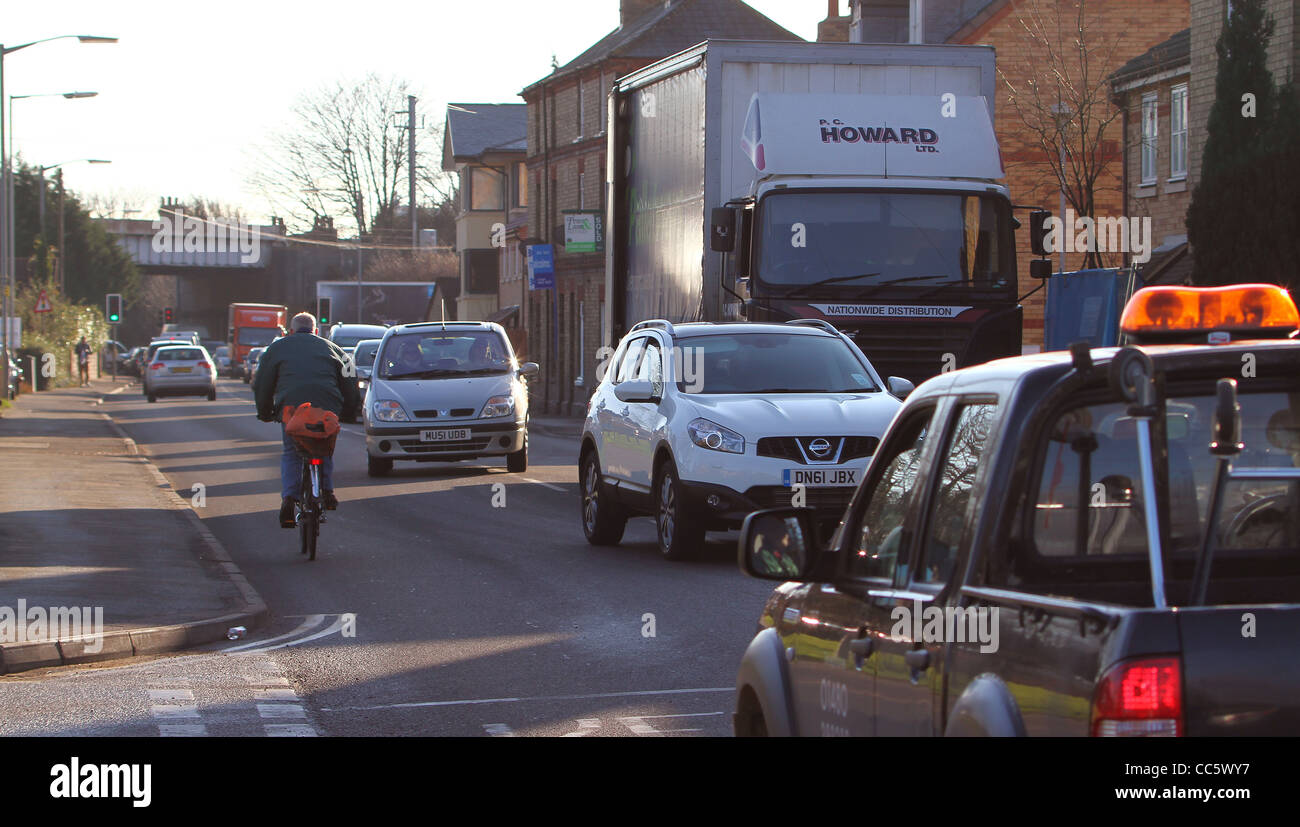 A delivery lorry parked awkwardly on a busy narrow road causes traffic congestion in Huntingdon, Cambridgeshire. - Stock Image