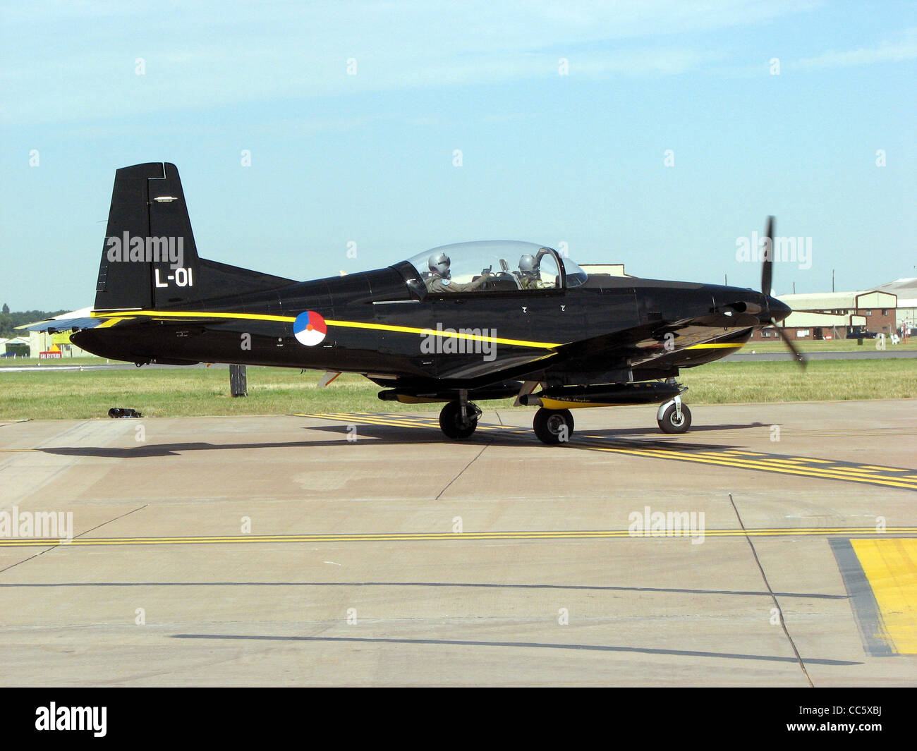Pilatus PC-7 Turbotrainer of the Royal Netherlands Air Force (identifier L-01) taxis for takeoff at the Royal International - Stock Image
