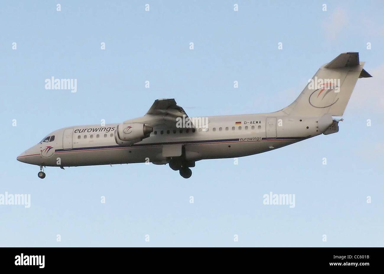 Eurowings British Aerospace 146-300 (with German registration D-AEWA) landing at London Heathrow Airport. - Stock Image