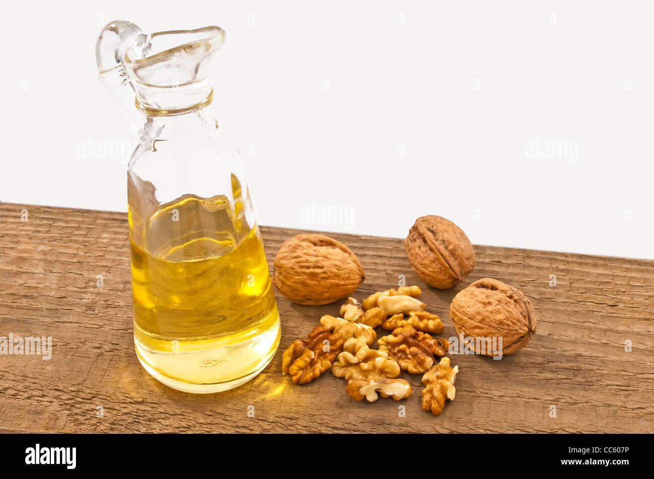 walnut oil with walnuts - Stock Image