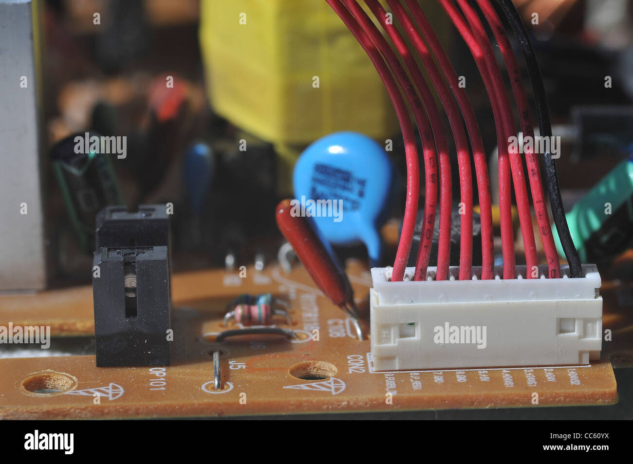Close up of an electronic circuit board. Electronic waste from Old Computers, is a major concern to ecologists around - Stock Image