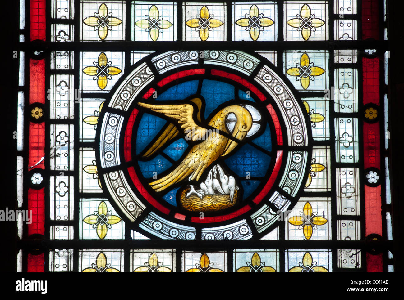 Pelican in its piety stained glass, St. Matthew`s Church, Salford Priors, Warwickshire, England, UK - Stock Image
