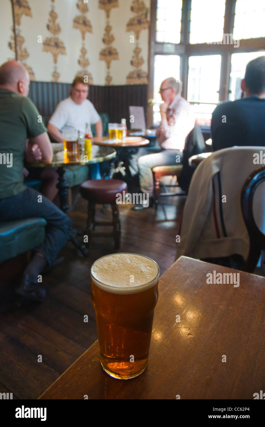 A pint of beer in a pub Soho central London England UK Europe - Stock Image