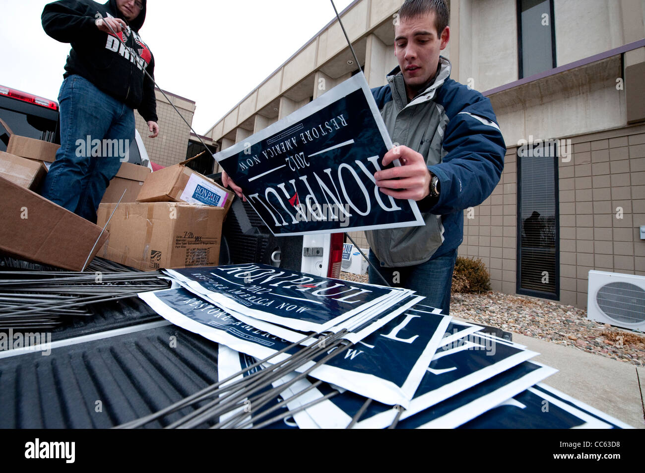 Supporter of Republican presidential candidate Ron Paul puts together signs at a campaign rally in Le Mars Iowa - Stock Image