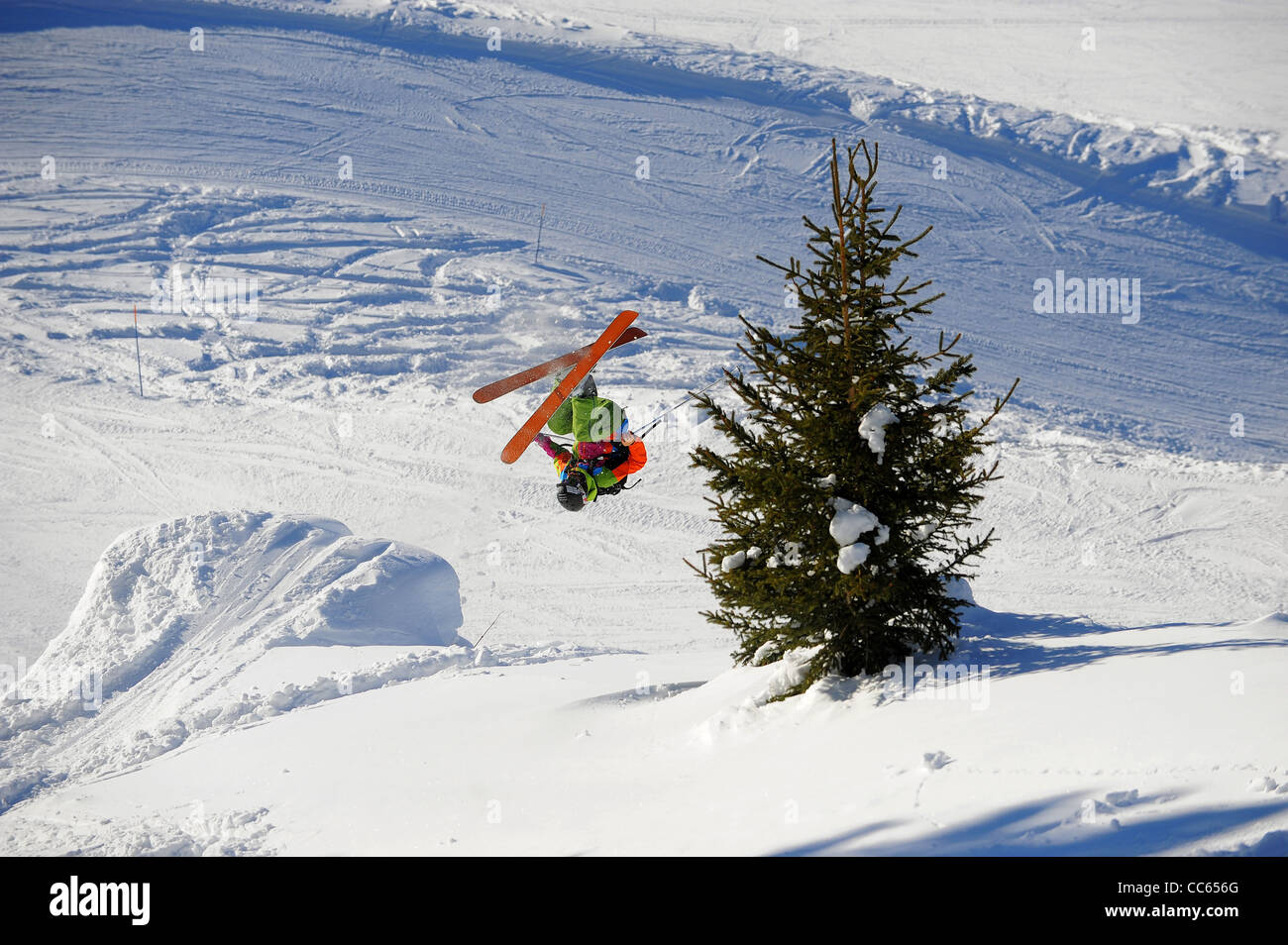 A skier performs a front flip in the French ski resort of Courchevel. - Stock Image