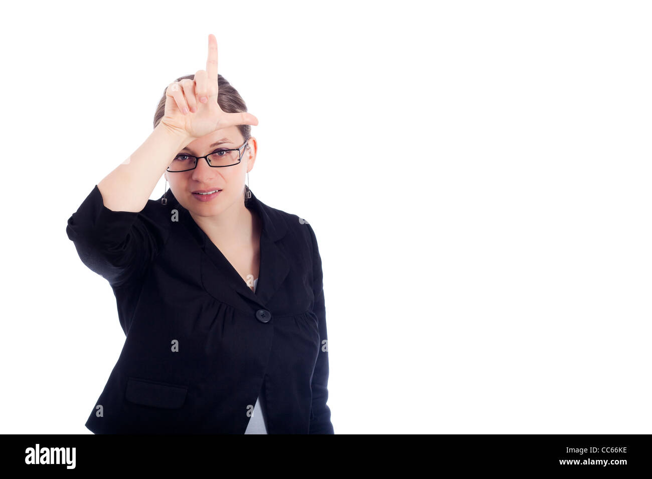 Young business woman gesturing loser sign, isolated on white background. - Stock Image
