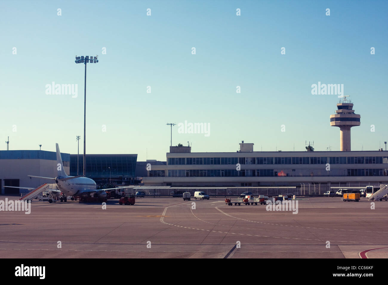 Airplane at an airport - Stock Image
