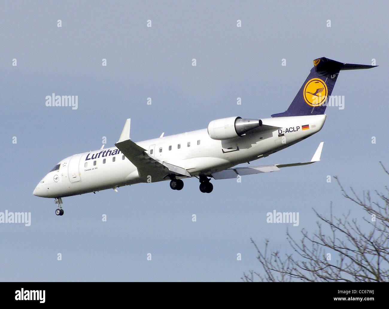 Lufthansa CityLine Canadair CL-600-2B19 regional jet (CRJ-100) (D-ACLP) landing at London Heathrow Airport, England. - Stock Image