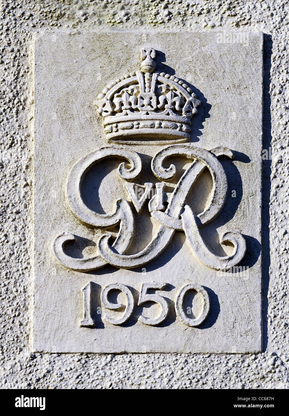A 1950 Royal insignia on an old telephone exchange at Gurnards head in Cornwall, UK - Stock Image