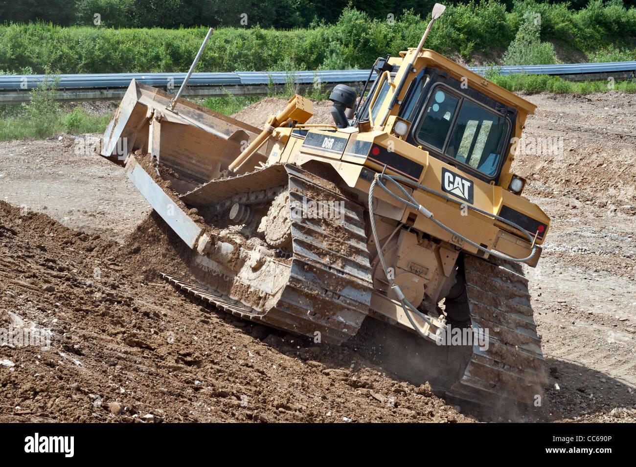 bulldozer in gravel pit - Stock Image