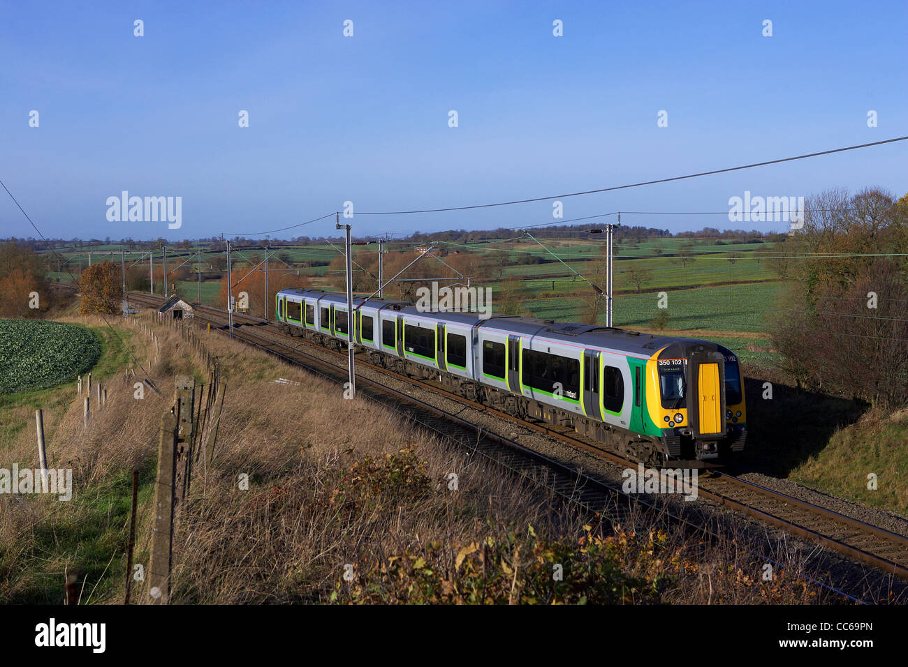 london midland class 350 heads south to london euston on a west coast mainline service november 2011. - Stock Image