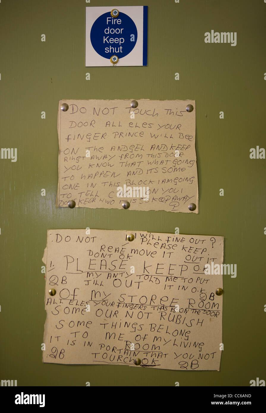 Keep Fire Door Shut Anti Social Notices handwritten warnings on Interior Door in Multiple Accommodation Liverpool UK & Keep Fire Door Shut Anti Social Notices handwritten warnings on ...