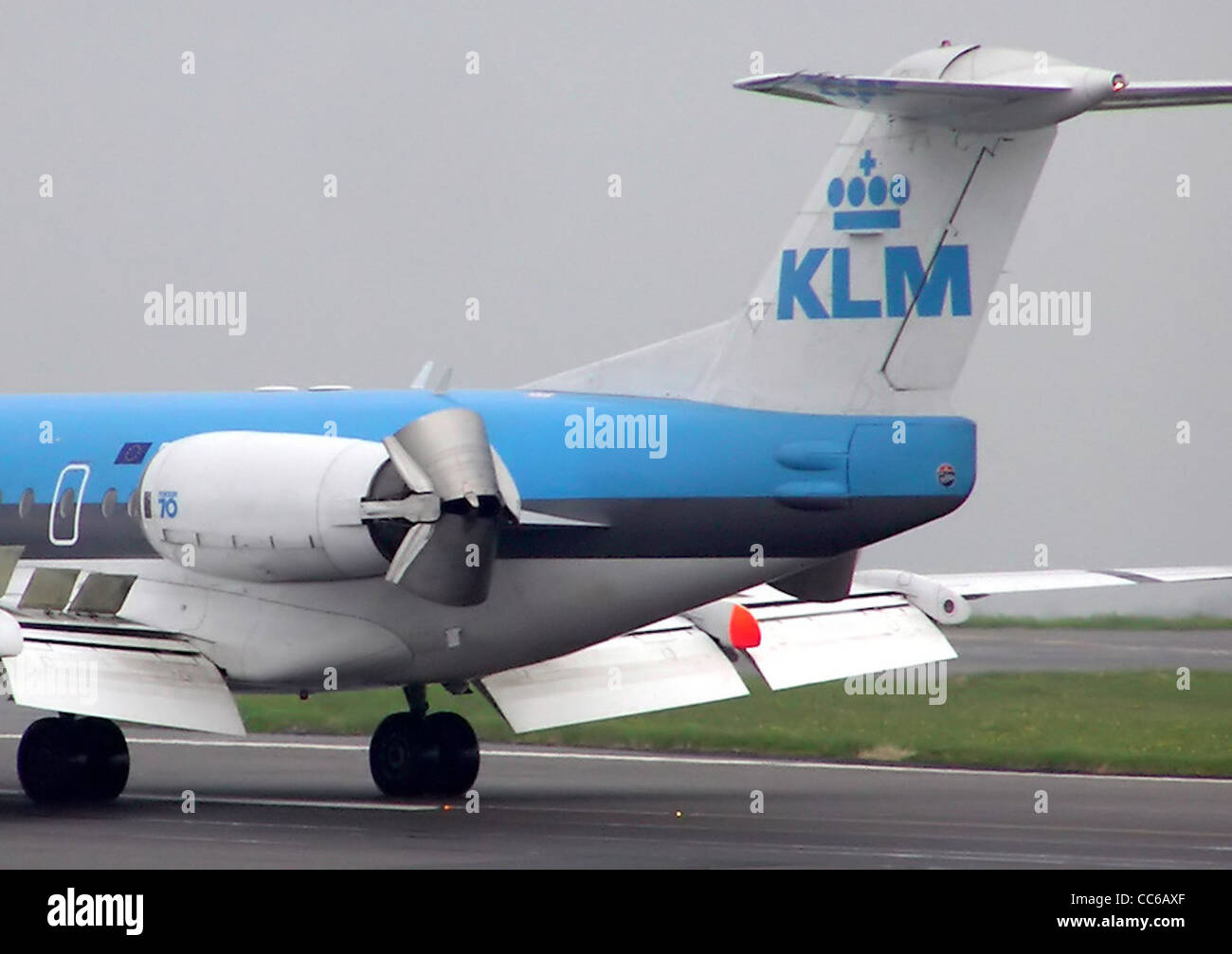 Reverse thrust on a Fokker 70 of KLM at Bristol International Airport, Bristol, England. - Stock Image