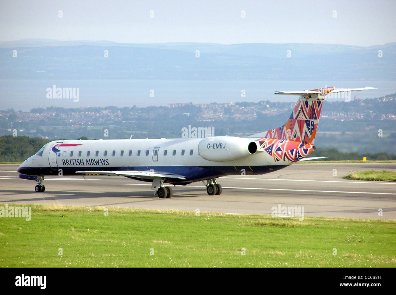 British Airways Embraer ERJ145 with Market Day ethnic fin . UK registration G-EMBJ, - Stock Image