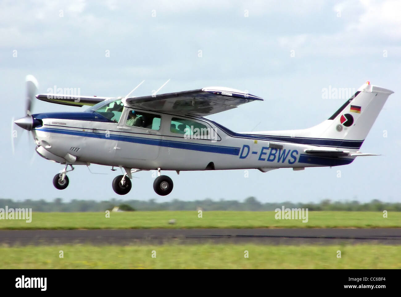 Cessna 210 Centurion (German registration D-EBWS), year of build unknown) at Kemble Airfield, Gloucestershire, England. - Stock Image