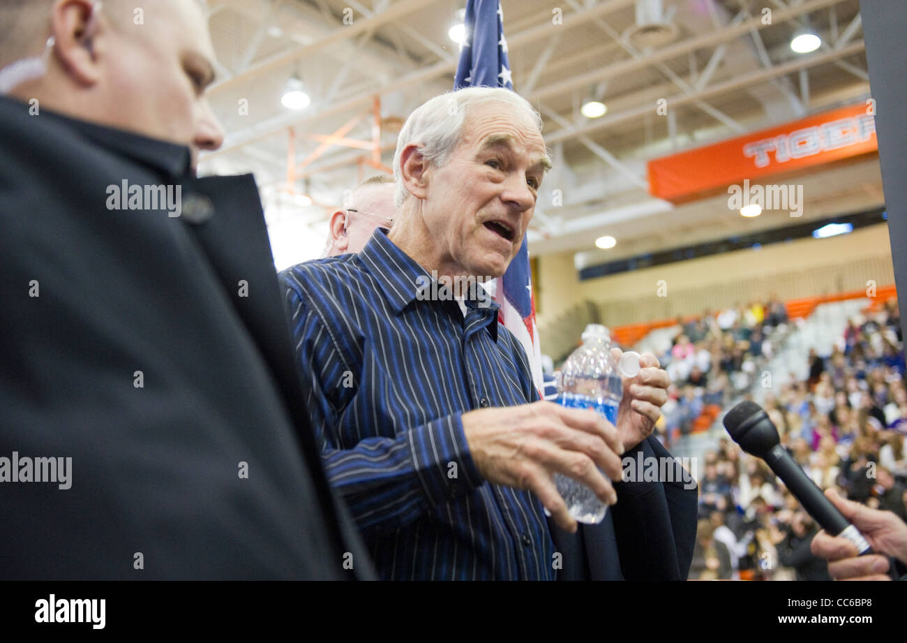 Republican presidential nominee candidate Ron Paul speaks to a reporter at campaign event in West Des Moines, Iowa - Stock Image