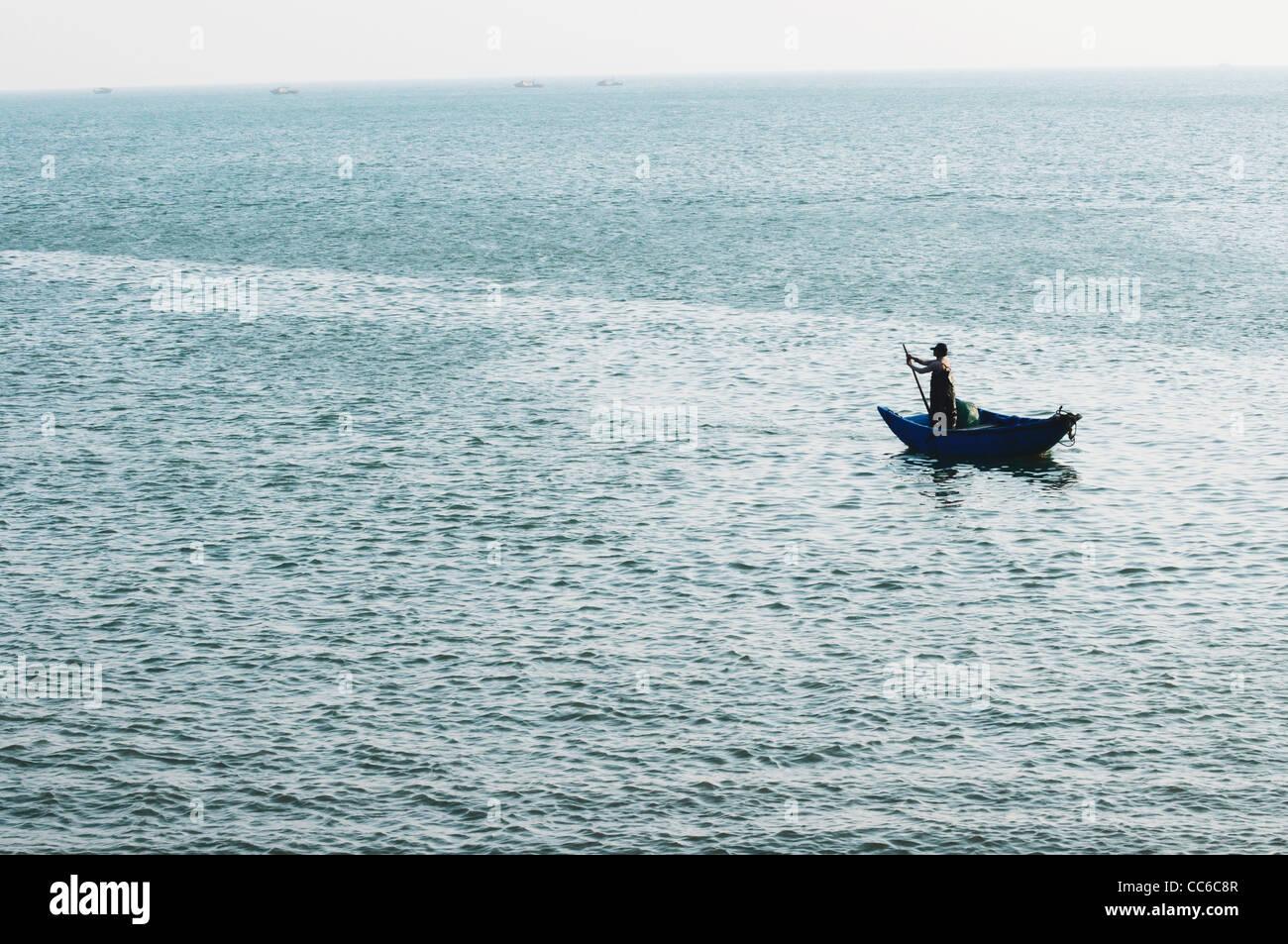 Man fishing on the South China Sea, Beihai, Guangxi , China - Stock Image