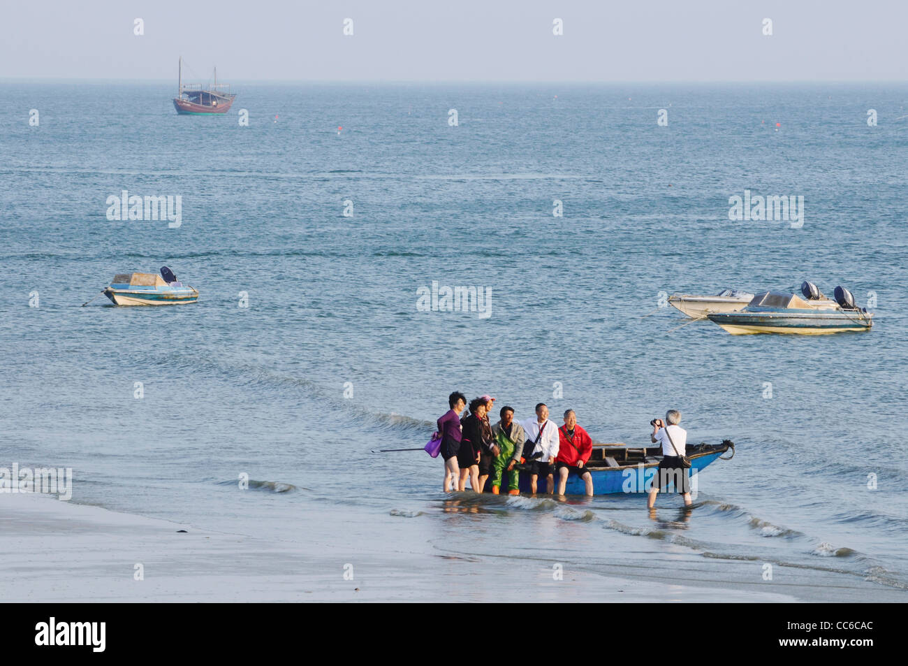 Tourists taking photos, South China Sea, Beihai, Guangxi , China - Stock Image