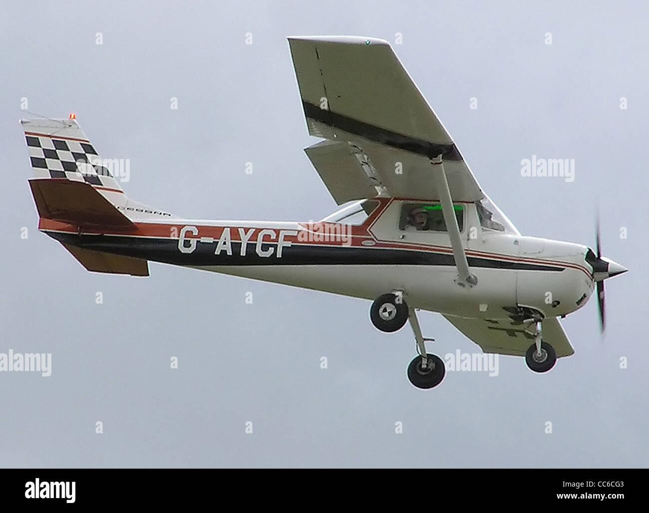 1970 Cessna FA150K (G-AYCF) landing at Hullavington airfield, Wiltshire, England. Built 1970. - Stock Image
