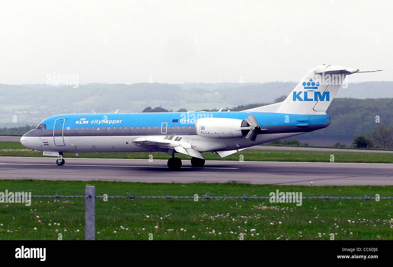 KLM Fokker 70 with reverse thrust applied, after touchdown at Bristol Airport, Bristol, England. - Stock Image
