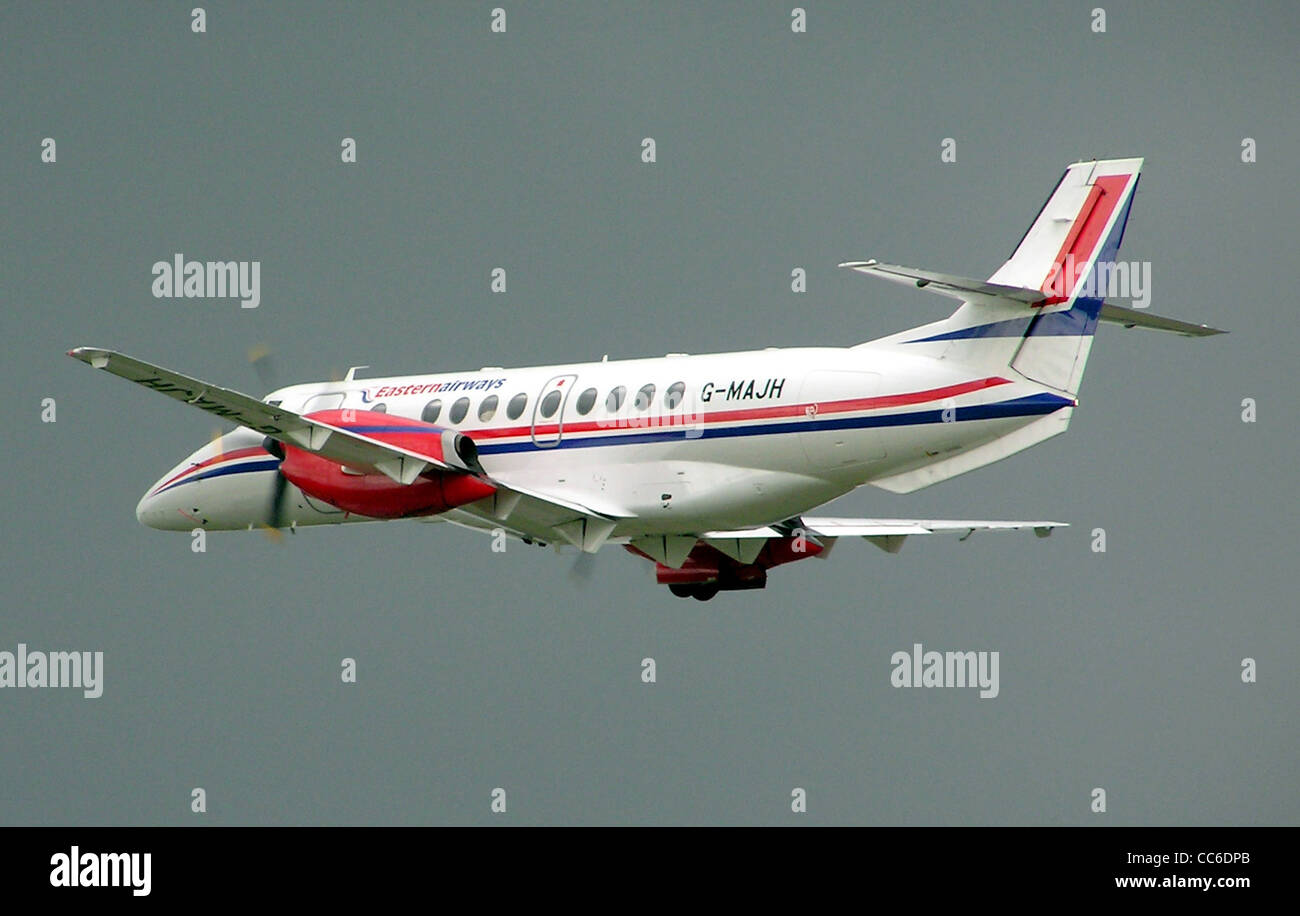 Jetstream 41 of Eastern Airways taking off from Bristol Airport, Bristol, England. - Stock Image