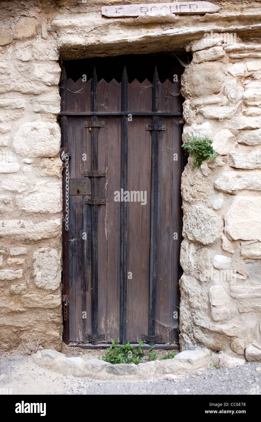 An old brown barred door in a stone wall in Saignon France - Stock Image & Door Barred Stock Photos \u0026 Door Barred Stock Images - Alamy