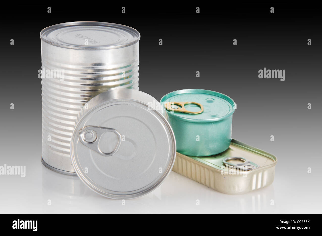 Four different shape and colors cans with a gradient background - Stock Image