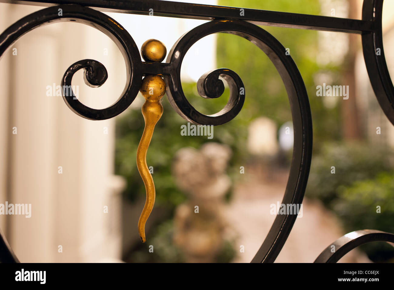 A closeup look at a hand-crafted iron gate at a hotel in Paris, France - Stock Image