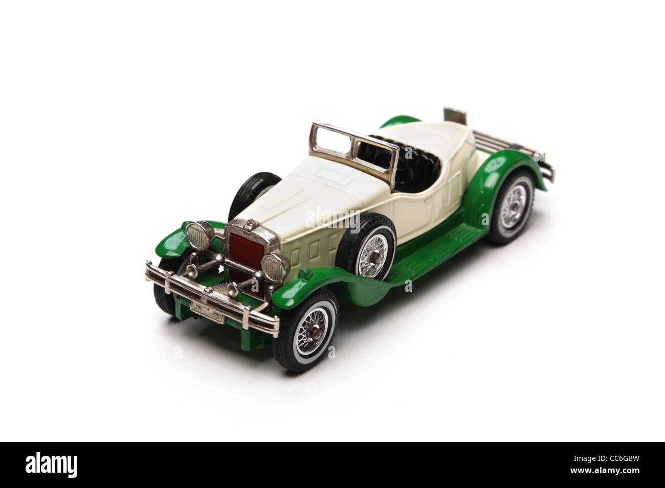 Old toy car close-up isolated on a white background. Shallow DOF. - Stock Image