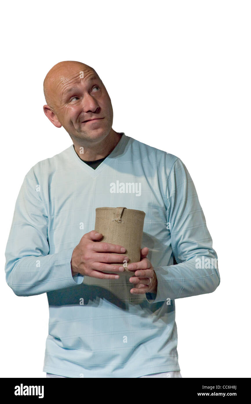 Rueful white bald man looks up holding begging pot - Stock Image