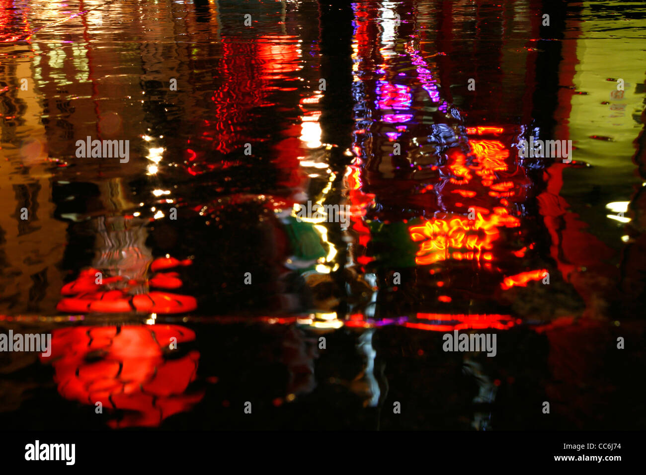 Rainy reflection of a Chinese lantern on Wardour Street, Chinatown, London, UK - Stock Image