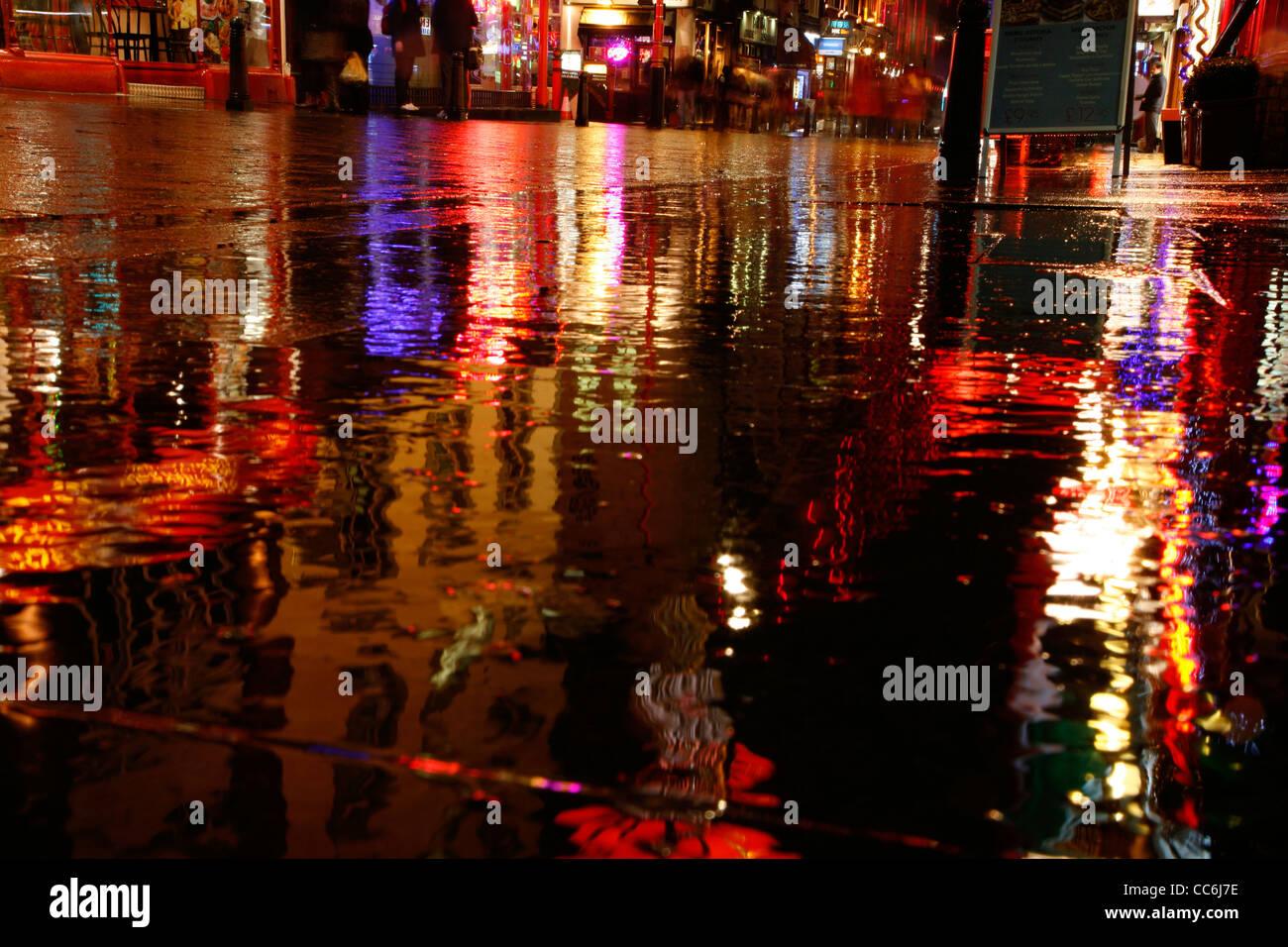 Rainy reflections on Wardour Street, Chinatown, London, UK - Stock Image