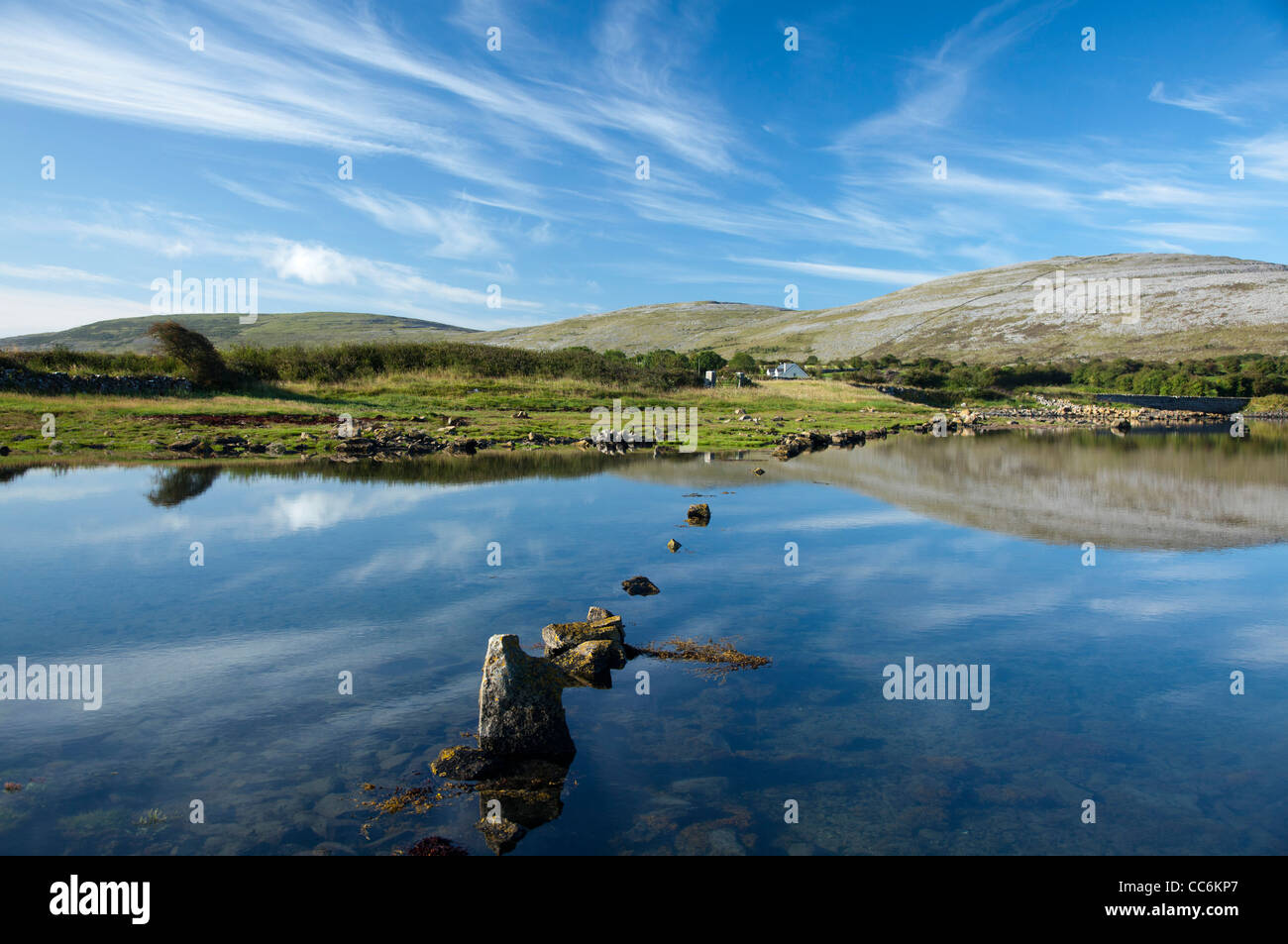 The limestone landscape of The Burren reflected in Ballyvaughan Bay, County Clare, Ireland. Stock Photo
