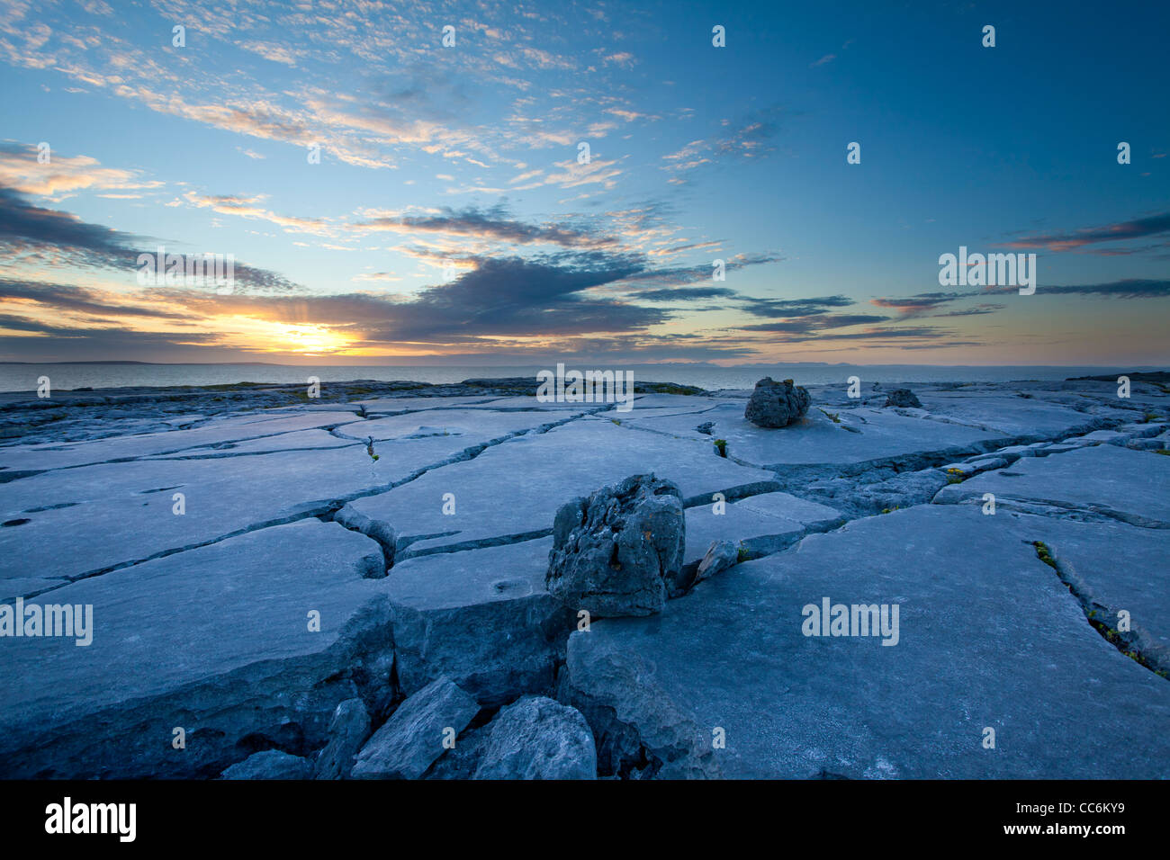 Sunset over the limestone pavement of The Burren, Fanore, County Clare, Ireland. - Stock Image