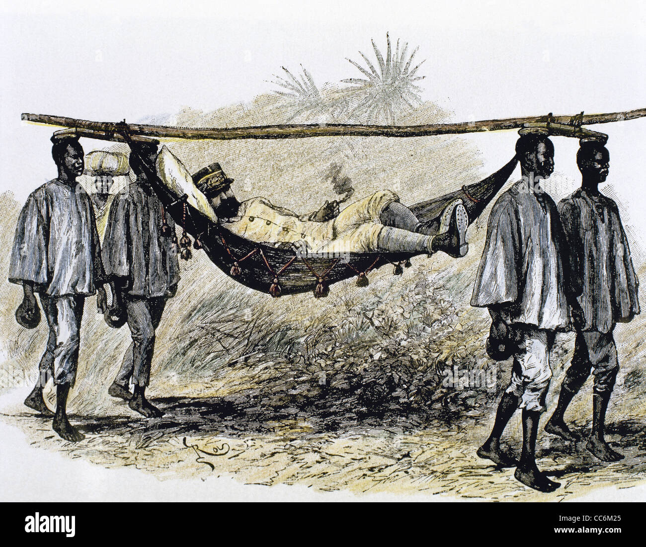 History of Africa. Colonialism. 19th century. European colonizer carried in a hammock by four African porters. - Stock Image