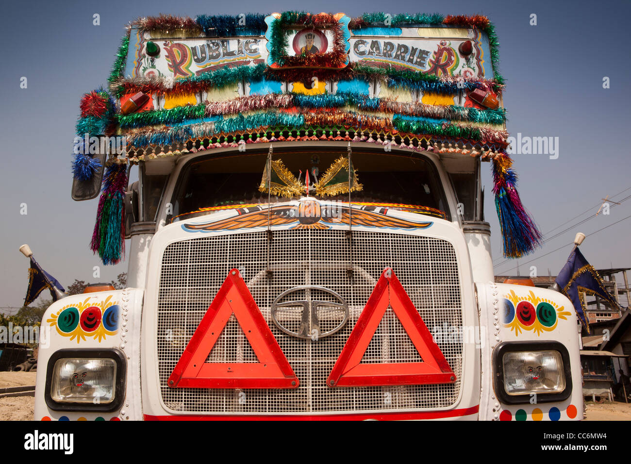 India, Assam, Balipari, colourful decoration on front of Tata Motors lorry - Stock Image