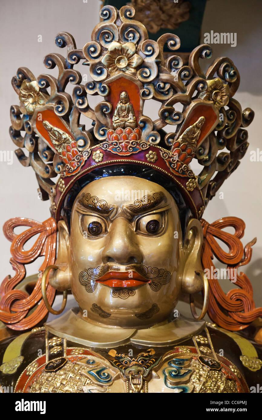 China, Hong Kong, Lantau, Interior of Po Lin Monastery, Temple Guardian Statue Stock Photo