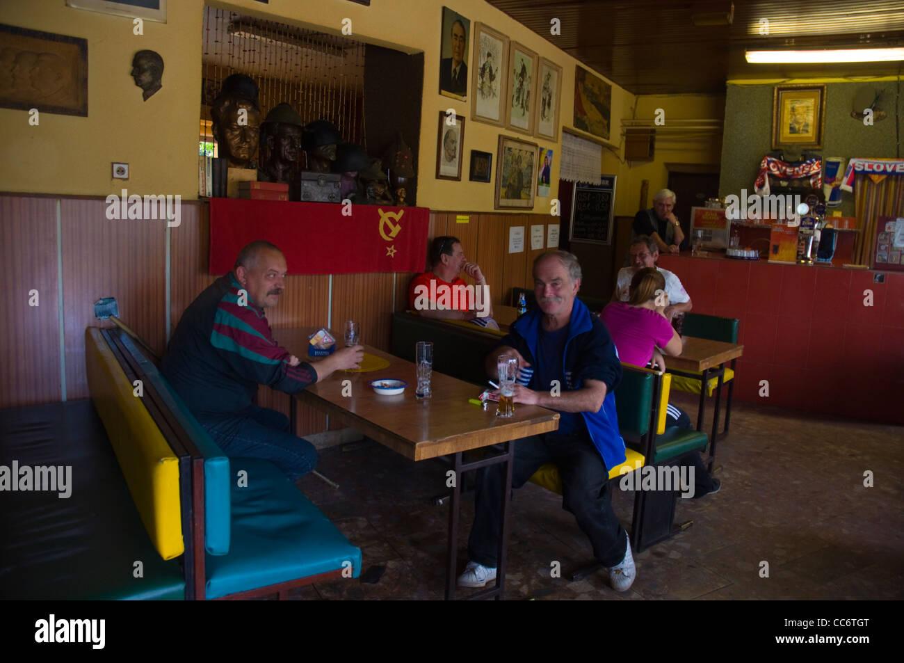 Locals in Communist theme bar along Sasinkova street central Žilina Slovakia Europe - Stock Image